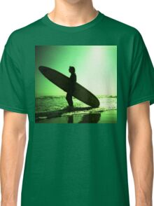 Surfer carrying surfboard in surreal silhouette in green in sea ocean water by beach 35mm analog xpro cross lomo lca photo Classic T-Shirt