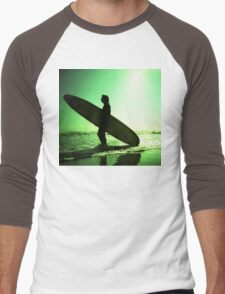 Surfer carrying surfboard in surreal silhouette in green in sea ocean water by beach 35mm analog xpro cross lomo lca photo Men's Baseball ¾ T-Shirt