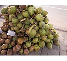 Tender coconuts ready for sale in a pile on the road side Photographic Print
