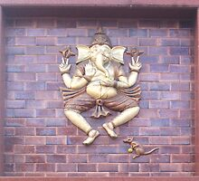 The Hindu God Ganesha with his pet rat on a wall sculpture by ashishagarwal74