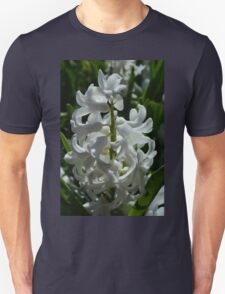 Spring white hyacinth flowers and green leaves. Floral garden photo. T-Shirt
