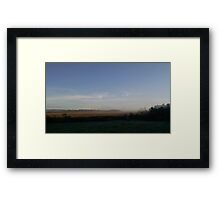 Layer of mist with blue sky over marsh Framed Print