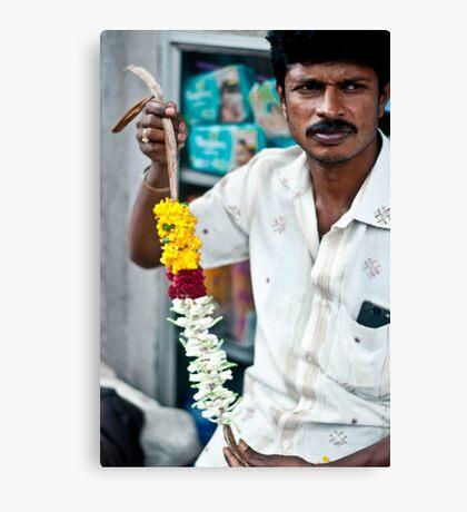 Candid portrait of a flower seller Canvas Print