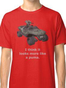 I think it looks more like a puma Classic T-Shirt