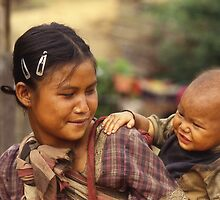Young Karen mother & baby. Northern Thailand. by Peter Stephenson