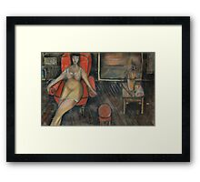 Woman in the arm-chair Framed Print
