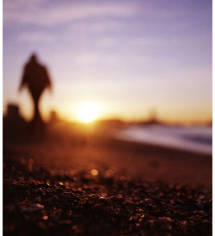 Man walking on beach at sunset square color analogue medium format film Hasselblad photograph Sticker