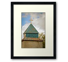 Cross and steeple on an old church Framed Print