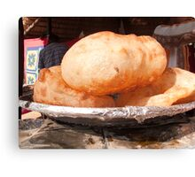 Close up of the Indian food deep fried dish of Bhature Canvas Print