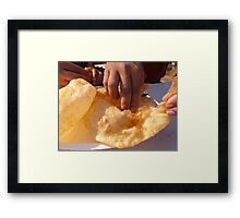 Eating by hand the Indian delicacy of Chole Bhature Framed Print