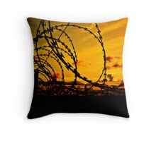 Sunset over razor wire Throw Pillow