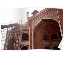 Sun peeking over the edge of the Humayun Tomb undergoing renovation Poster