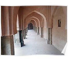 Archways, pillars and the long corridor of an old Baoli in Mehrauli in Delhi Poster