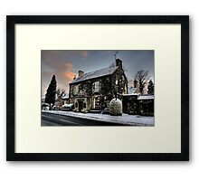 The Rock In The Snow Framed Print