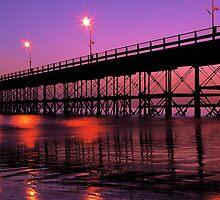 Pier silhouette at dusk by Gabriel Skoropada