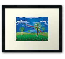 Blooming tree on grass field Framed Print