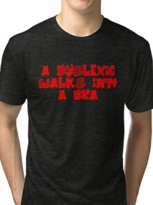 A dyslexic walks into a bra Tri-blend T-Shirt