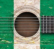 Old Vintage Acoustic Guitar with Nigerian Flag by Jeff Bartels
