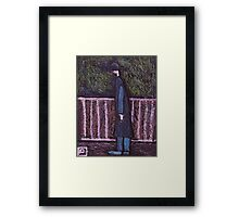 A man looking at something Framed Print