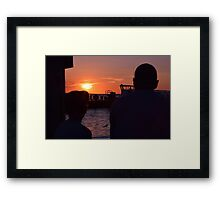 a father and son on the pier  Framed Print