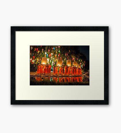 Monks releasing paper Chinese lantern at loy krathong festival of light  Framed Print