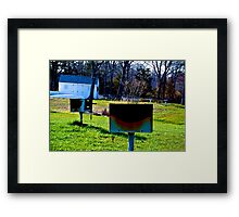 Charcoal Grills Near a Boat House Framed Print