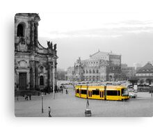 Modern yellow tram at a historical location  Canvas Print