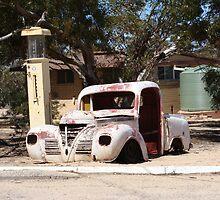 Car in the desert by Elena Martinello