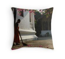 A Monk Sweeps Bougainvillea Leaves in Luang Prabang, Laos Throw Pillow