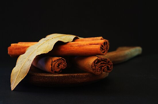 wooden spoon and cinnamon by Clare Colins