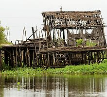 Abandoned Wooden House on Stilts by Artur Bogacki