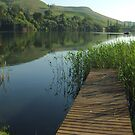 Lake reflections from the jetty, Drakensberg, South Africa by Fineli