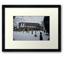 Malmesbury Abbey in the Snow Framed Print