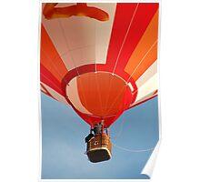 Orange and White Striped Hot Air Balloon in Flight Over Blue Sky Poster