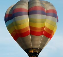 Multicoloured Striped Hot Air Balloon in Flight over Bristol by HotHibiscus