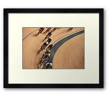 Cycling in a curve Framed Print