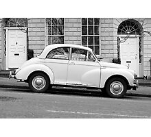 Morris Minor 1000 vintage British motor car parked on a hill in Bath England  Photographic Print