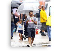 aziz ansari walking in rain with umbrella  Canvas Print