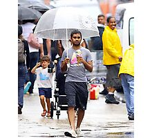 aziz ansari walking in rain with umbrella  Photographic Print