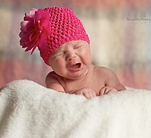 Newborn with Pink Bonnet by Yannik Hay