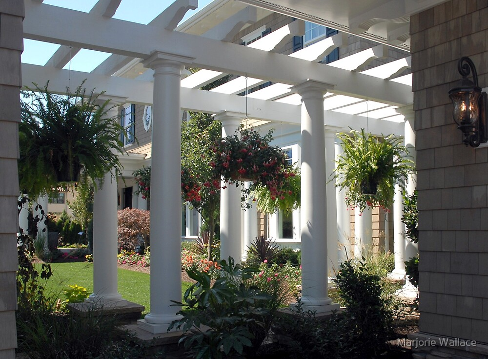 Pergola and hanging baskets by Marjorie Wallace