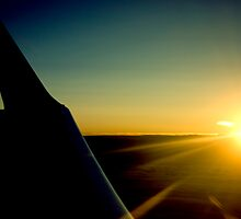 Sunrise from 26000ft by Al Ronberg