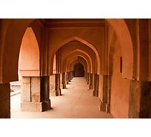 Archways, pillars and the long corridor of an old Baoli in Mehrauli in Delhi in landscape Photographic Print