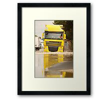 Large DAF articulated lorry driving through summer flash flooding road condition in Britain 2007 Framed Print
