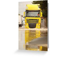 Large DAF articulated lorry driving through summer flash flooding road condition in Britain 2007 Greeting Card
