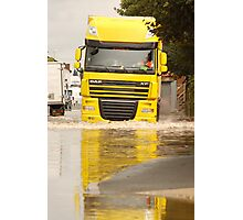 Large DAF articulated lorry driving through summer flash flooding road condition in Britain 2007 Photographic Print