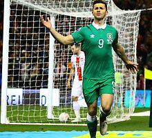 Shane Long celebrates scoring for Ireland by Billy Galligan
