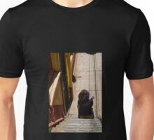 Reading on the stairs Unisex T-Shirt