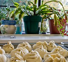 a tray of wontons waiting to be cooked by pmacimagery