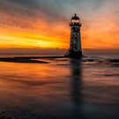 Lighthouse At Sunset by Adrian Evans